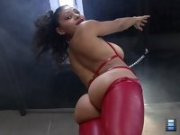 Red Boot Agony: She tramples full weight with her sharp heels and she looks tremendous in her red, crotch high boots.