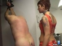 No mercy whipping: Miss Dolce tortures her slave with one of her harsher whips..