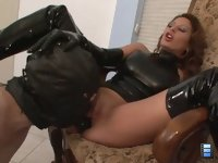 Face Fucked Boot Slut: Mistress Giselle straps a dildo gag into his mouth and face fucks him until she cums.