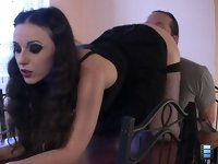 Table Ass Lick: Bended slightly, Goddess leaned back to slave�s face forcing his tongue to enter her anus..