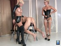 Caned Pussy Licker: With his balls tied down, the slave has no choice but to submit to the caning..