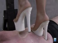Brutal Beauty Trample: She looks totally hot as she tests how much pain he can handle under her very high and sharp heels.