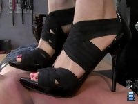 Losers Get Trampled: She loves to see the kisses that her high heels make on their skin. Check it out!