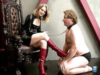 She allows him a few licks of her beautiful boots before slapping him more and more.
