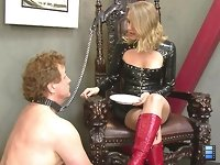 Mistress Yuliya has her slave chained up to the her throne. She is sitting their with a plate in her hand. Why? Because it hasn't been washed properly.