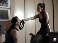 Licking Slave: She wanted him to take a good view at her main weapon, feel the inevitability of impending torture and realize his complete helplessness before it.