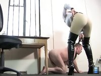 Belted And Booted: Mistress Ashleigh can't help absent mindedly tormenting him as She chats and of course he reacts by yelping and interrupting Her call. Eventually in fury, She terminates the call and sets about him to teach him a lesson.