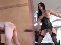 Belted Bitch Boy: Colby discovers a slave who is hiding and masturbating under the steps. She puts him on a leash and drags him before Mistress Megan.
